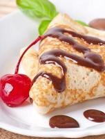 pancakes with chocolate and cherries