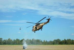 Military helicopter shooting photo