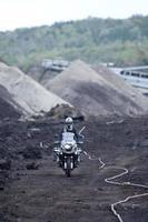 Man Riding Adventure Motorcycle Through Mud