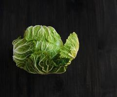 cabbage on a black wooden boards photo