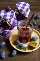 Plum jam in glass photo