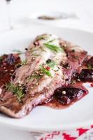 Fish fillet with red wine and plum sauce photo