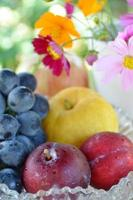 fruits with cosmos flowers photo