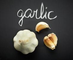 garlic on black background photo