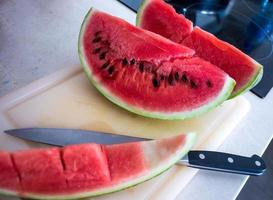 Watermelon Slices on Chopping Board with Knife