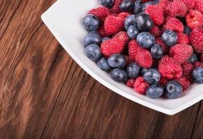 Raspberries with blueberries photo