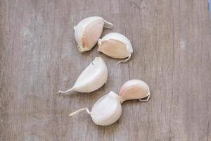 Garlic on wood surface photo