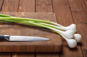 Fresh garlic on chopping board