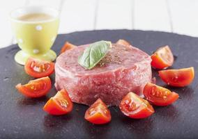 Raw meat and tomatoes photo