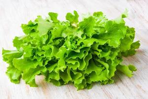 Fresh lettuce on a wooden table photo