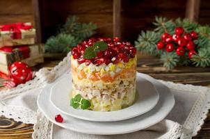 Layered salad from vegetables on the holiday table