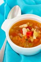 vegetable soup in bowl and spoon photo