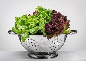 Fresh lettuce in a metal colander. photo