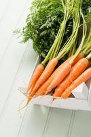 Carrots on wooden table photo