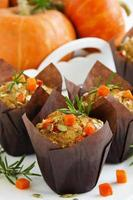 Pumpkin muffins with rosemary and seeds.