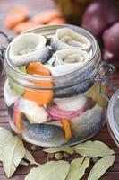 Pickled herring in a jar on a table