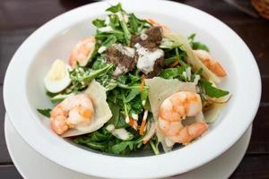 salad of arugula with shrimp