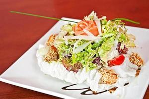Caesar salad with salmon photo