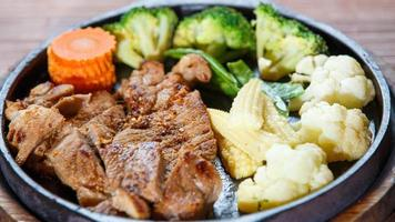 Juicy grilled pork chop (neck cut) with vegetables photo