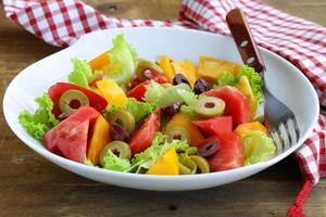 salad of colorful tomatoes and olives photo