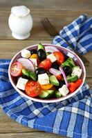 Delicious salad with fresh vegetables and feta photo