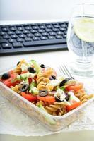 healthy snack in the office - plate of fresh salad