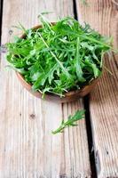 Fresh arugula in a bowl photo