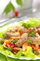 Warm salad with meat and fried vegetables