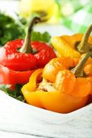 Red and yellow peppers stuffed with meat