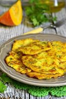 Pumpkin fritters with garlic and dill.