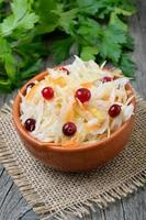 Vegetable salad with cabbage, carrots and cranberries photo