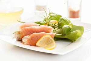 Smoked salmon roll with vegetable salad photo