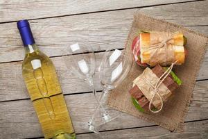 Two sandwiches and white wine