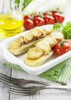 Zucchini with meat, tomatoes and cheese photo