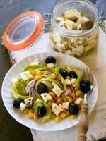 Diet salad with zucchini, olives, corn and marinated fresh chees photo