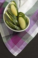 Zucchini sliced on Pink Scottish plaid tablecloth.