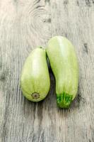 The two zucchini on wooden background