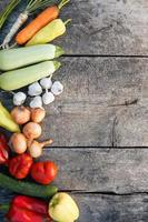Fresh vegetables on old wooden background