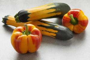 Fresh striped peppers and zucchini