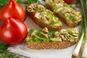 Bruschetta with grilled zucchini.  Soft focus photo