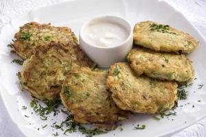Pancakes with zucchini and sour cream