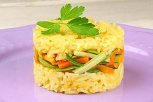 Saffron rice with crunchy vegetables photo