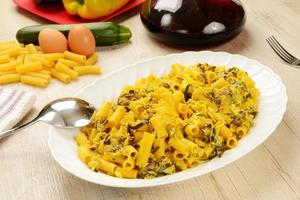 Pasta with zucchini and eggs photo