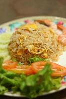 Fried rice with shrimp on the plate photo