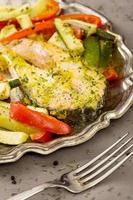 piece of baked fish and vegetables
