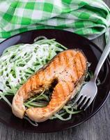 Grilled salmon with cucumber salad photo