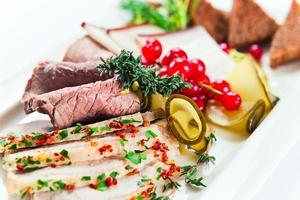 Cold snack with meat and spices photo