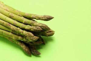 Asparagus on green background photo