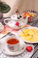 Warm cup of tea and sweets photo