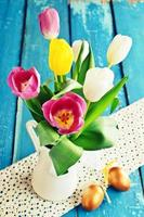 Tulips of different colors in the vase